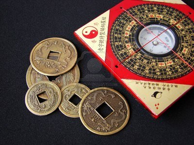 4292717-feng-shui-compass-luopan-and-chinese-coins-on-black-background